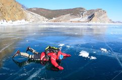 Baikal lake, Russia, March, 13, 2017.Russia, Olkhon island. Tourist looking from Baikal ice in march. Baikal lake, Russia, Olkhon island. Tourist looking from Royalty Free Stock Photo