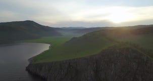 The Baikal lake shore and amazing sun on the horizon stock video footage