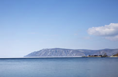 Baikal lake spring landscape view. Snow-covered shore of the lake. Rocky forested coastline. Baikal lake spring landscape view. Snow-covered shore of the lake Royalty Free Stock Photo