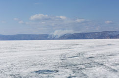 Baikal lake spring landscape view. Snow-covered surface of the ice lake. Winter. Stock Image