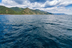 Baikal lake view. Baikal water with waves and clouds on background royalty free stock photography