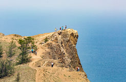 Baikal, Russia - July 24, 2015: a tour group enjoying the views. From the northernmost Cape of Olkhon island, Cape Khoboy stock image