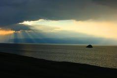 Baikal and sunbeams. Sunset with the sunbeams. Baikal lake Stock Photography