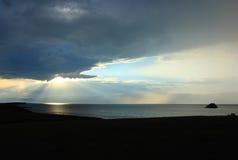 Baikal and sunbeams. Sunset with the sunbeams. Baikal lake Royalty Free Stock Image