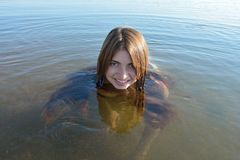 Baikal young, beautiful girl smiling floats Royalty Free Stock Image