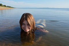 Baikal young, beautiful girl smiling floats Royalty Free Stock Photography