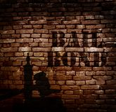 Bail bond brick. Bail Bond text on a brick wall, with gavel and scale stock images