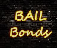 Bail bond brick. Neon Bail Bond sign on a brick wall Royalty Free Stock Photography
