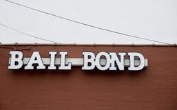 Bail Bond Corporation. A bail bondsman, bail bondsperson, bail bond agent or bond dealer is any person, agency or corporation that will act as a surety and stock photo