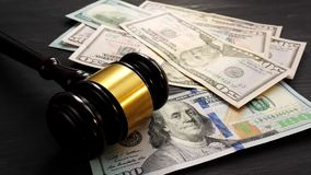 Bail bond and corruption concept. Gavel and money is dropping on a desk in a court. Bail bond and corruption concept. Gavel and money is dropping on a desk in stock video footage