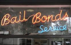Bail bond sign. Neon Bail Bond sign in window stock image
