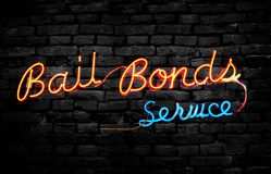 Bail Bond sign on wall. Neon Bail Bonds Service sign on a brick wall royalty free stock photo