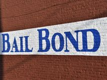 Bail Bondsman Bondsperson Corporation. Bail Bond. A written promise signed by a defendant or a surety one who promises to act in place of another to pay an stock photos