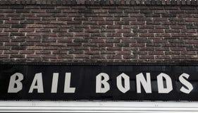 Bail Bonds sign. On brick building exterior royalty free stock photo