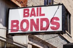 Bail Bonds sign chained to a building I Stock Image