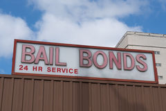 Bail Bonds Sign. On top of building stock image