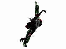 Bailarín acrobático de la rotura del hip-hop breakdancing el hombre joven que salta el si Foto de archivo libre de regalías