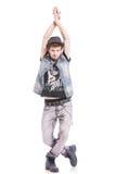 Bailarín con las manos y las piernas cruzadas Foto de archivo libre de regalías