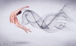 Bailarín de ballet moderno que se realiza con remolino abstracto Imagen de archivo