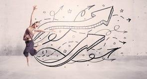Bailarín de la calle con las flechas y las estrellas Foto de archivo
