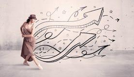 Bailarín de la calle con las flechas y las estrellas Imagenes de archivo