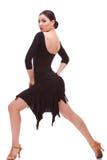 Bailarín de la mujer de la salsa que hace una estocada Fotos de archivo