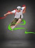 Bailarín de sexo masculino que salta en el aire Fotografía de archivo libre de regalías