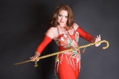 Bailarín de vientre con el bastón Imagenes de archivo