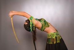 Bailarín de vientre con el sable Imágenes de archivo libres de regalías