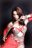 Bailarín de vientre con la espada Imágenes de archivo libres de regalías