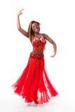 Bailarín de vientre joven en una vuelta foto de archivo