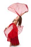 Bailarín de vientre joven que da vuelta con las fundas del velo imágenes de archivo libres de regalías