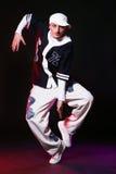 Bailarín del salto de la cadera en danza Foto de archivo libre de regalías