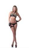Bailarín joven atractivo que presenta en traje erótico Fotos de archivo libres de regalías