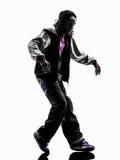 Bailarín moonwalking de la rotura del hip-hop breakdancing el silhouet del hombre joven foto de archivo