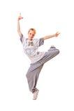 Bailarín sonriente que se coloca en una pierna Imagen de archivo