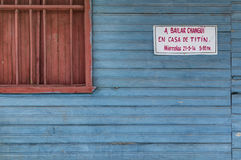 A bailar Changuì. An invitation for dancing lessons attached to an old wooden house. Changuì is the typical music genre of the region of Guantanamo, Cuba Royalty Free Stock Photography