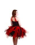 Bailarina en alineada del rojo y del negro. Imagen de archivo