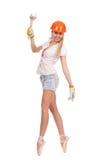 Bailarina en casco anaranjado Imagen de archivo libre de regalías