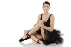 Bailarina en la sentada negra Foto de archivo libre de regalías