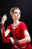 Bailarina en tutú rojo en negro aislado Imagen de archivo libre de regalías