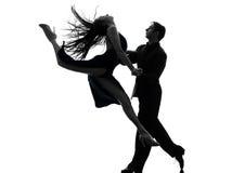 Bailarines del salón de baile de la mujer del hombre de los pares tangoing la silueta Fotos de archivo libres de regalías
