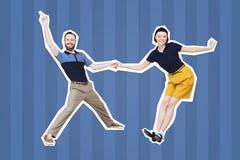 Bailarines del woogie de la boogie de la danza del salto de Lindy o del rollo del ` del ` n de la roca imágenes de archivo libres de regalías