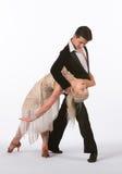 Bailarines latinos del salón de baile con el vestido grisáceo - Bent Back Imágenes de archivo libres de regalías