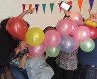 Baile al ritmo de los globos Imagenes de archivo