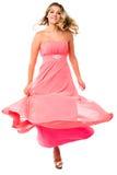 Baile atractivo de la mujer y el remolinar en vestido de fiesta foto de archivo