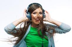 Baile de la muchacha del adolescente de la música contra fondo blanco aislado Fotografía de archivo