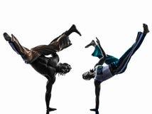 Baile de los bailarines del capoeira de los pares   silueta Imagen de archivo libre de regalías