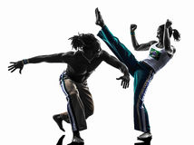 Baile de los bailarines del capoiera de los pares   silueta Imagen de archivo