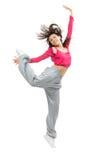 Baile de salto del hip-hop del adolescente delgado bastante moderno del estilo Imagen de archivo libre de regalías